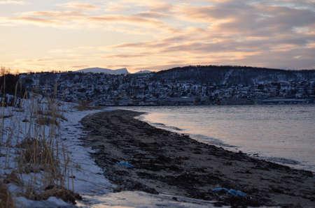 mainland: tromsoe city island seen from the mainland sea shore