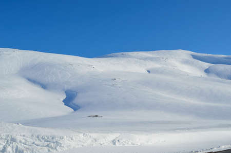artic circle: deep snow on mountain peak