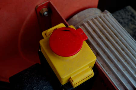 cut off saw: red emergency stop button on wood saw