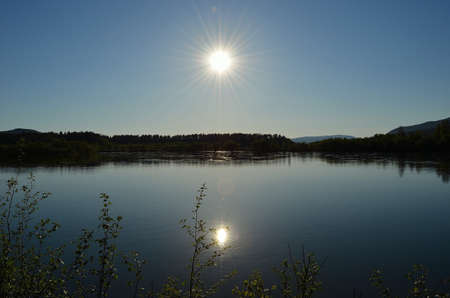 white salmon river: sun and sunshine reflection on calm river surface in spring time Stock Photo