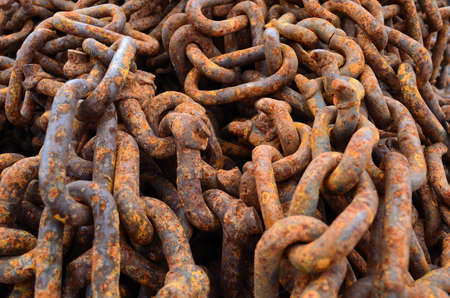 rusted heavy duty chains in a pile photo
