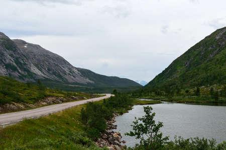 long lake: long mountain road and lake in summer