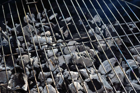 artic circle: barbecue grill close up with coal