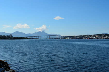 Tromso bridge and the city of Tromso in the warm summer photo