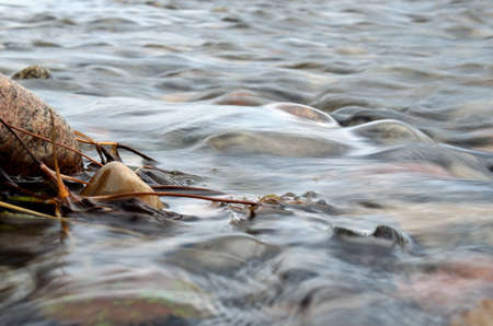 mesmerising: Beautiful mesmerising dreamy photo of water flowing over a rock in the cold river