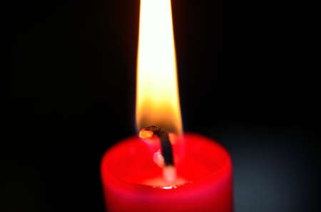 Macro photo of warming red candle flame