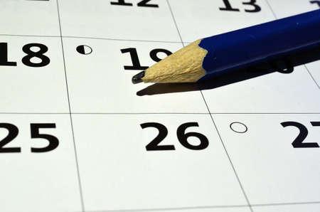 Blue pencil on a personal calendar macro photo photo