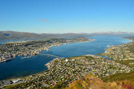 Sunny overview photo of the arctic city of Tromso photo