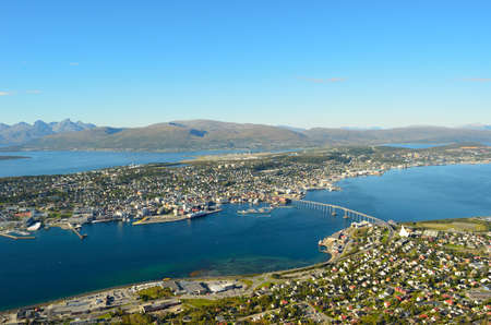 Amazing photo of Tromso city on a sunny autumn day photo