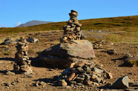 artic circle: stone cairn on a mountain in Tromso Stock Photo