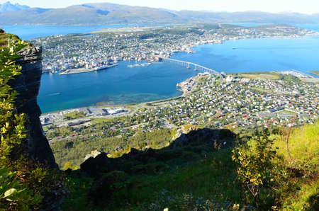 Amazing photo of Tromso city on a sunny autumn day photo