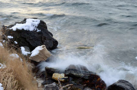 deep freeze: Stack of newspapers dumped on the sea shore in Norway gets battered by the cold sea water Stock Photo