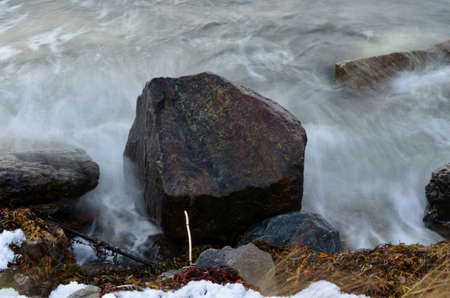 Big boulder gets bashed by cold arctic waves in Norway in the middle of october