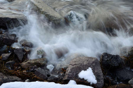 sub zero: Incoming cold arctic wave bashing the shore rocks