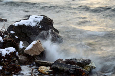 Small patches of snow on the stones by the sea shore in the arctic circle in the middle of october Reklamní fotografie