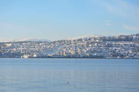 artic circle: tromsoe city island on a sunny blue day
