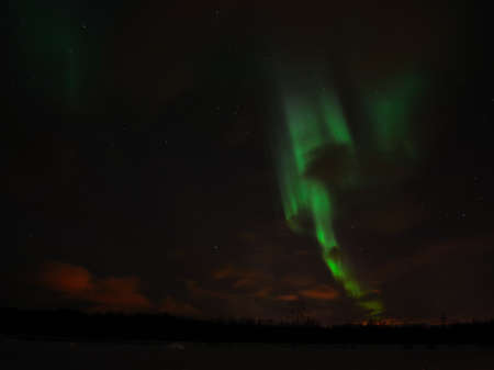 Aurora borealis, northern light, dancing on the arctic sky in december photo