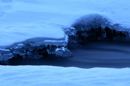 arctic waters: Frozen arctic river water creates beautiful ice shapes in winter macro photo