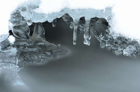 fine tip: Frozen arctic river water creates beautiful ice shapes in winter macro photo