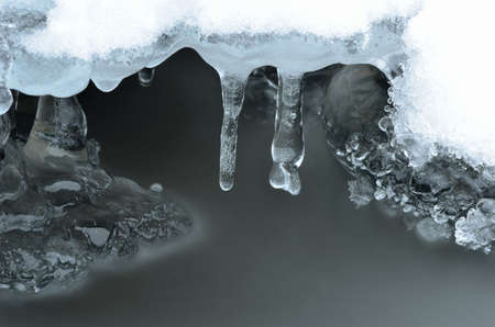 arctic waters: frozen ice shapes and river water flow in winter beauty macro photo