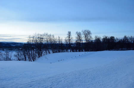 artic circle: blue winter sky and snowy landscape in the deep north