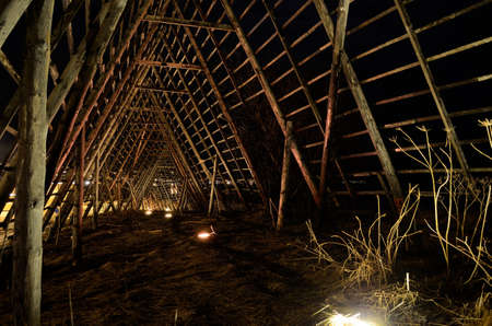stockfish: long, deep and beautiful wooden stockfish strucutre for drying fish at night time Stock Photo