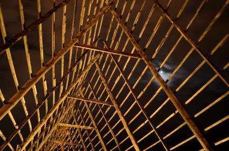 stockfish: beautiful wooden stockfish drying strucutre at night time with moonlight in the arctic circle