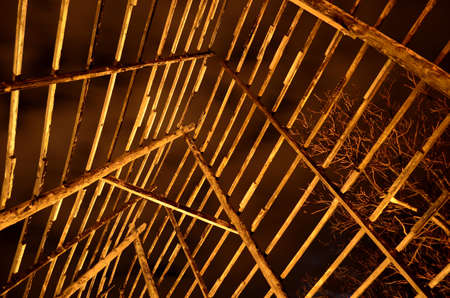 stockfish: beautiful wooden stockfish drying strucutre at night time in the arctic circle