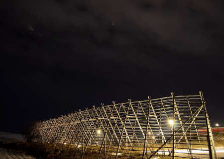 stockfish: beautiful wooden stockfish structure at night in the arctic circle