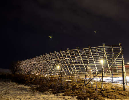 beautiful wooden stockfish structure at night in the arctic circle photo