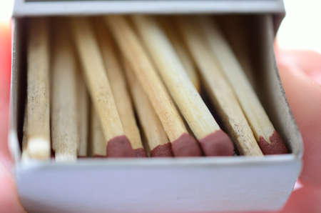 unlit: Matchbox with new and used matches sticks