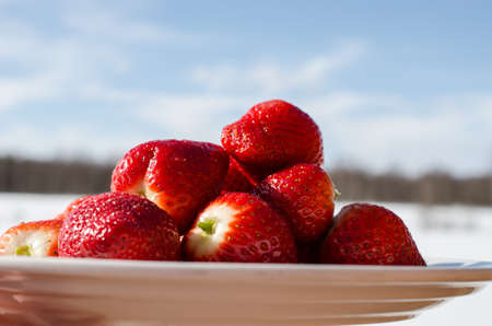 sweet red strawberries with blue sky background Stock Photo