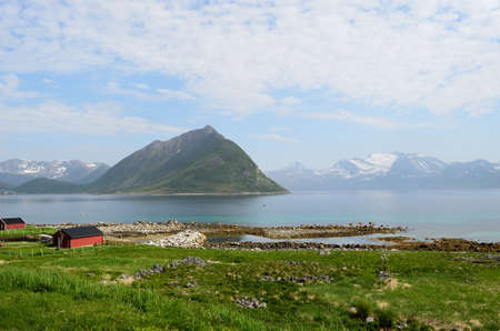 settlement surrounded by mountains and clear fjord water