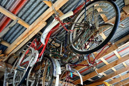 rafters: old bicycles hanging from roof rafters