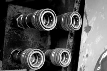 four hydraulic oil connection plugs on heavy duty machinery