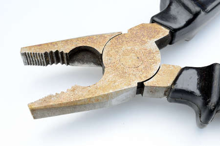 flatnose: black and rusted Flat-nose pliers isolated on white background macro photo