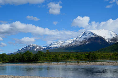 artic circle: river and mountain with snow in summer Stock Photo
