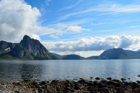 blue summer sky, mighty mountain and blue fjord water photo