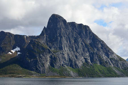 mighty mountain in fjord photo