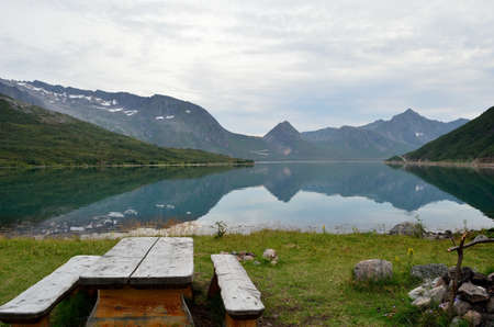 serene fjord surrounded by mountains in summer photo