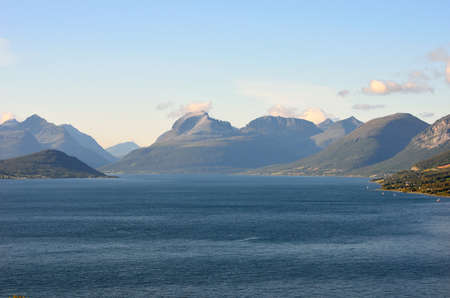 mountain and fjord landscape in autumn with the sleeping soldier mountain formation in the background photo