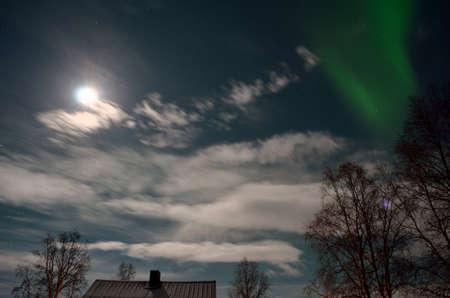 artic circle: aurora borealis, northern light in arctic landscape