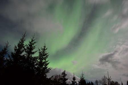 majestic aurora borealis in arctic circle winter landscape photo
