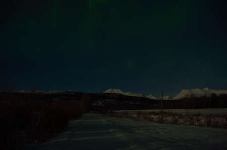 artic circle: aurora borealis, northern light in the arctic circle at night time