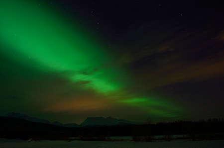 artic circle: beautiful aurora borealis over arctic circle landscape in winter