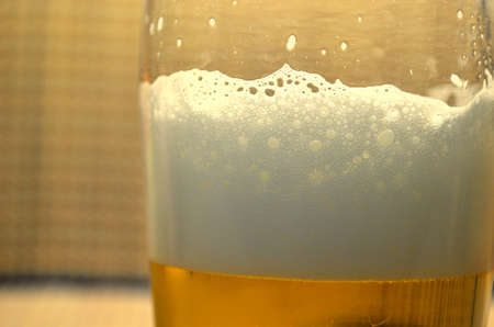 near beer: cold glass of beer