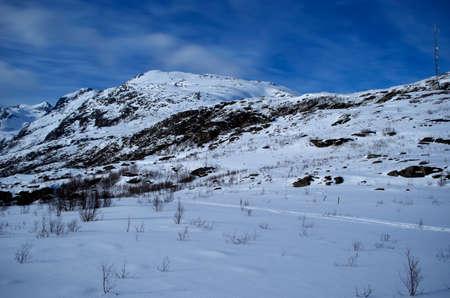 range of motion: Blue easter sky over white mountain landscape