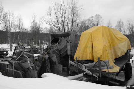 yellow tarp on trailer with cement mixer photo