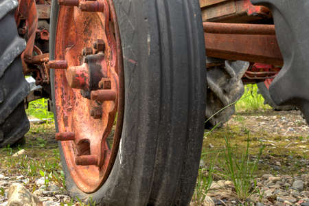 outside machines: old red rusted tractor wheel