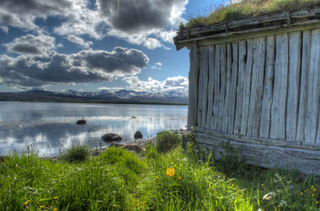 boathouse: old beautiful weathered boathouse near ocean